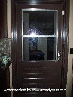 [Kitchen Door leading to garage]