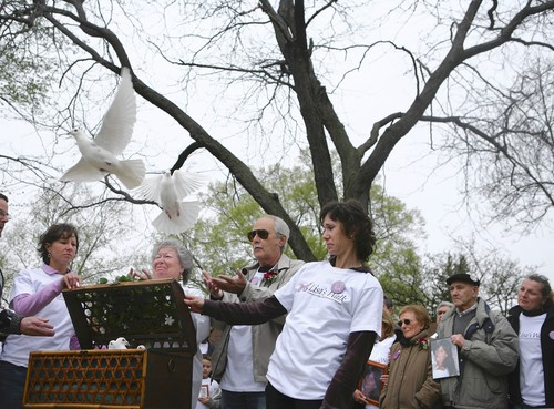 [Family of Lisa Stebic gather in Plainfield on Sunday and release doves to mark the one-year anniversary of her disappearance. (Tribune photo by E. Jason Wambsgans / April 27, 2008)]