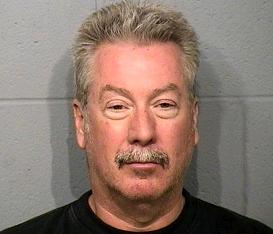 [Drew Peterson arrested 05/21/2008 on Felony gun charge - Bolingbrook, Illinois - Screen Capture from http://www.nbc5.com/slideshow/news/16352038/detail.html]