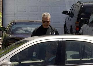 [Drew Peterson walks into his lawyer's car to hand himself in on Wednesday in Bolingbrook. (Terence Guider-Shaw/Naperville Sun)]