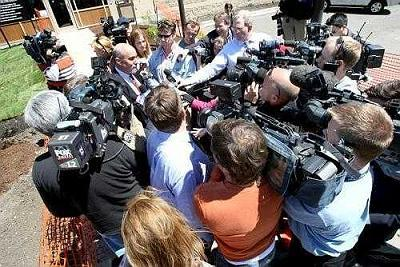 [Drew Peterson's lawyer, Joel Brodsky, is surrounded by media Wednesday at the Will County Jail after Peterson turned himself in on weapons charges]