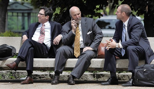 [Drew Peterson's attorneys ( left to right ) Andrew Abood, Joel Brodsky and Kris Tieber, wait outside the Will County Courthouse in Joliet before the start of the afternoon hearing on Thursday. (Tribune photo by John Smierciak / May 22, 2008)]
