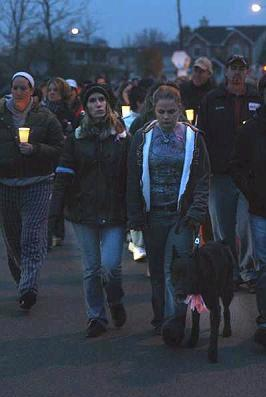 [November 17, 2007 Candle Light Vigil Walk For both Stacy Peterson and Kathleen Savio at 4:00 P.M. - Sun-Times Photo Caption: Stacy Peterson's sister Cassandra Cales leads the candle light visual with her dog down Pheasant Chase Court in Bolingbrook on Saturday evening in hopes of finding her sister Stacy Peterson.   (Terence Guider-Shaw/Staff Photographer)]