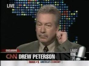 [Drew Peterson on Larry King Live April 11, 2008 tugging on his ear lobe]