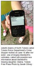 [Jobeth Adams of North Toledo holds her cellphone showing the call she and her husband made to Toledo Police Department's Crime Stoppers tip line on June 18th]