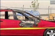 [Birgfeld's torched 2005 Red Ford Focus, from FoxNews]